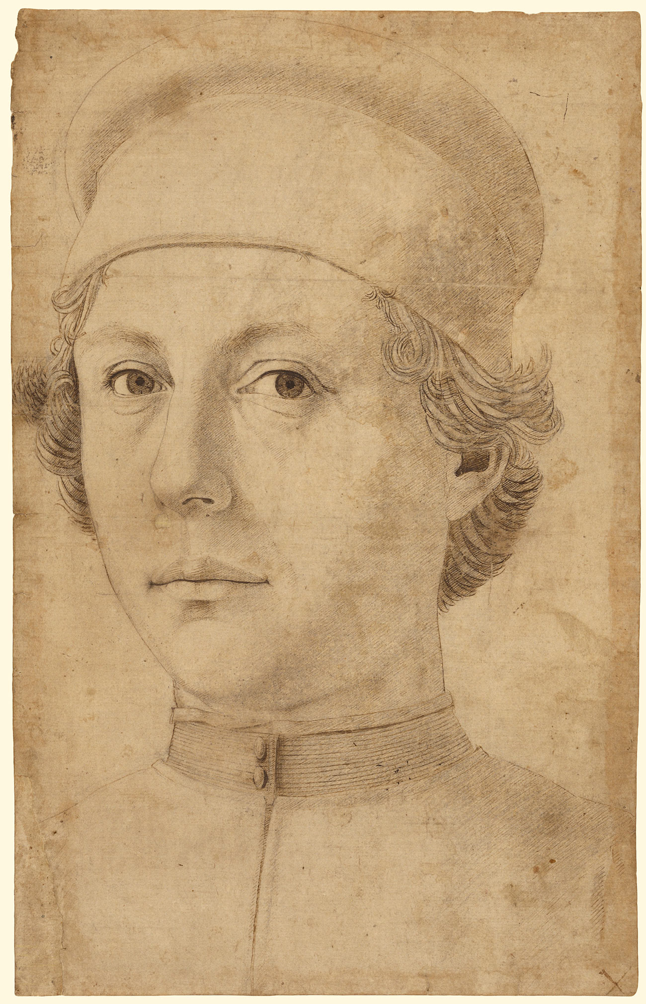 Drawing with fine lines in brown ink on sepia paper showing a young man in a snug cap, making direct eye contact with the viewer