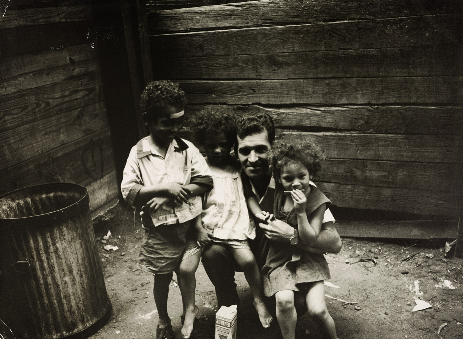 Photographer Henri Ballot with children in the slums of New York.