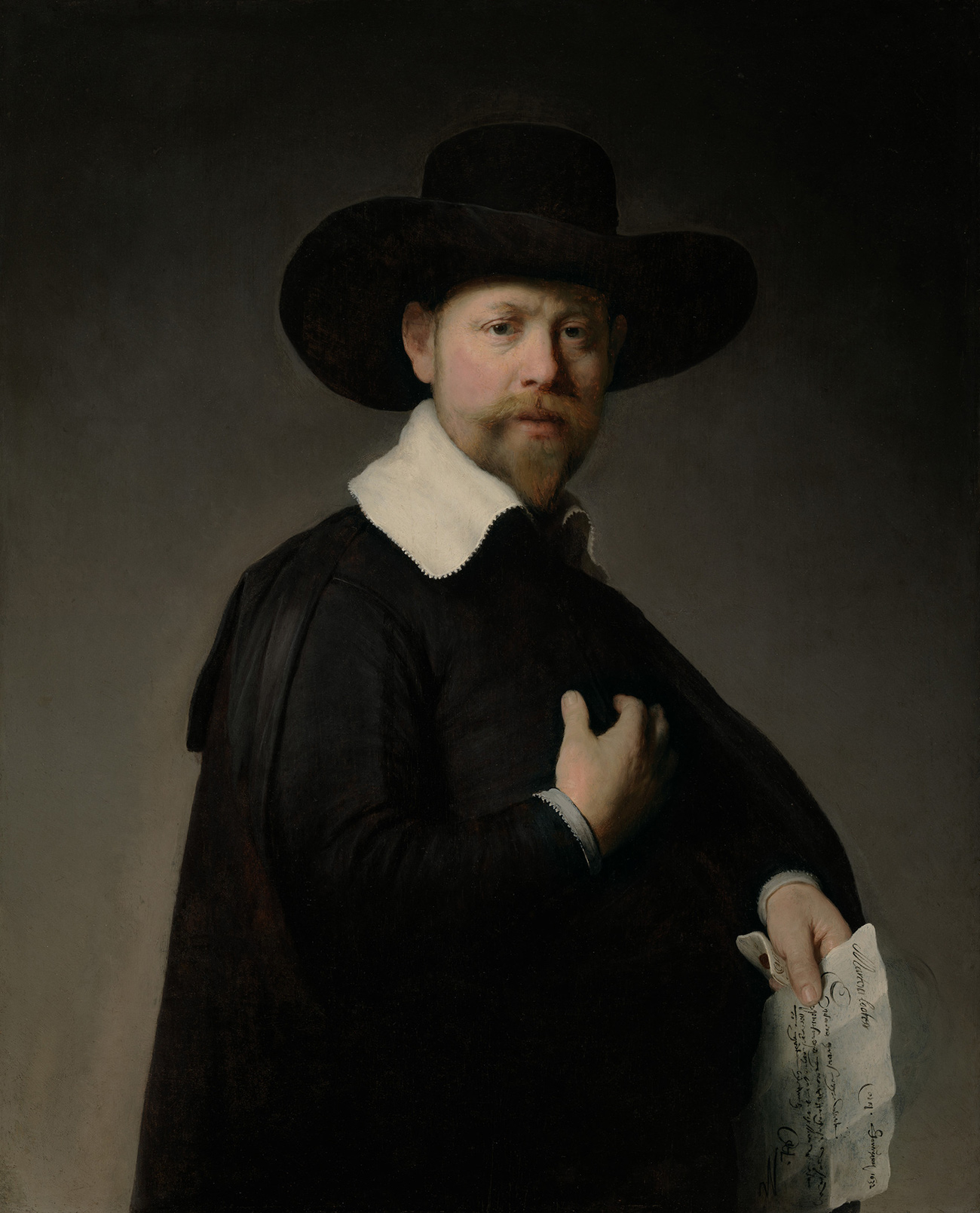 Somber portrait of a man with a pointy beard and small bushy mustache. He's wearing a wide-brimmed hat, wide white collar, and black cloak over a black jacket, and is holding a letter in his left hand.
