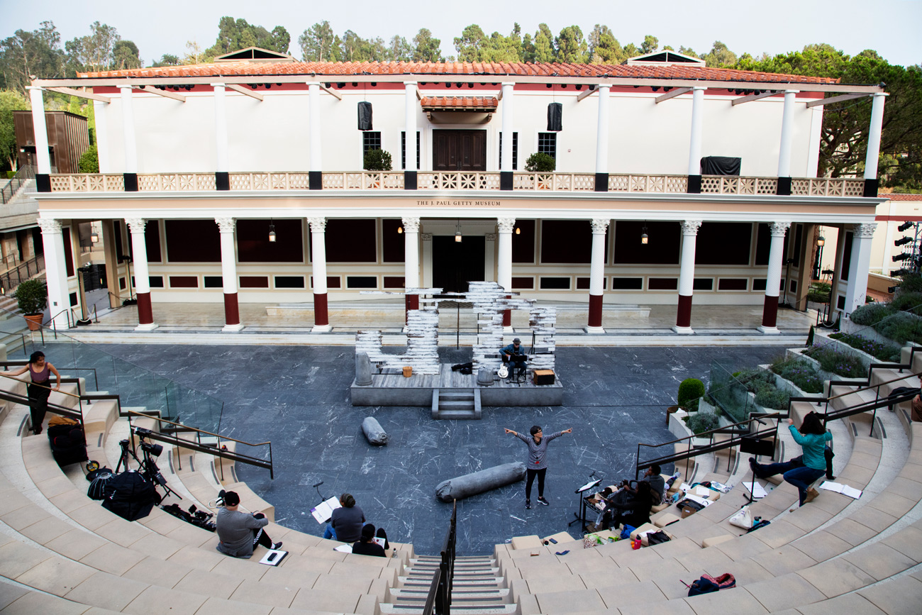Wide-angle view of the Getty Villa outdoor theater with the beginnings of a set for an ancient play