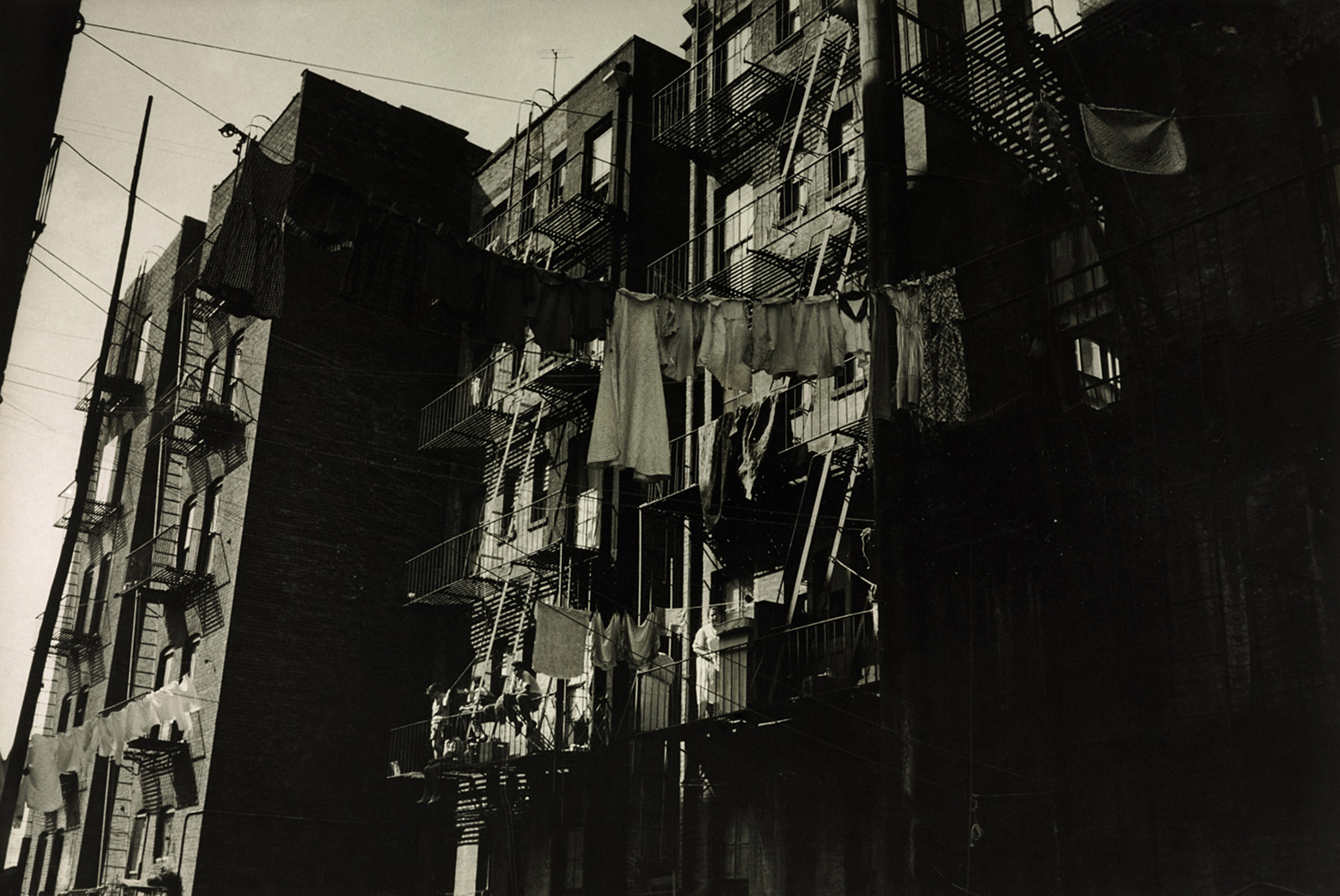 View of a side of a building with clothes hanging.