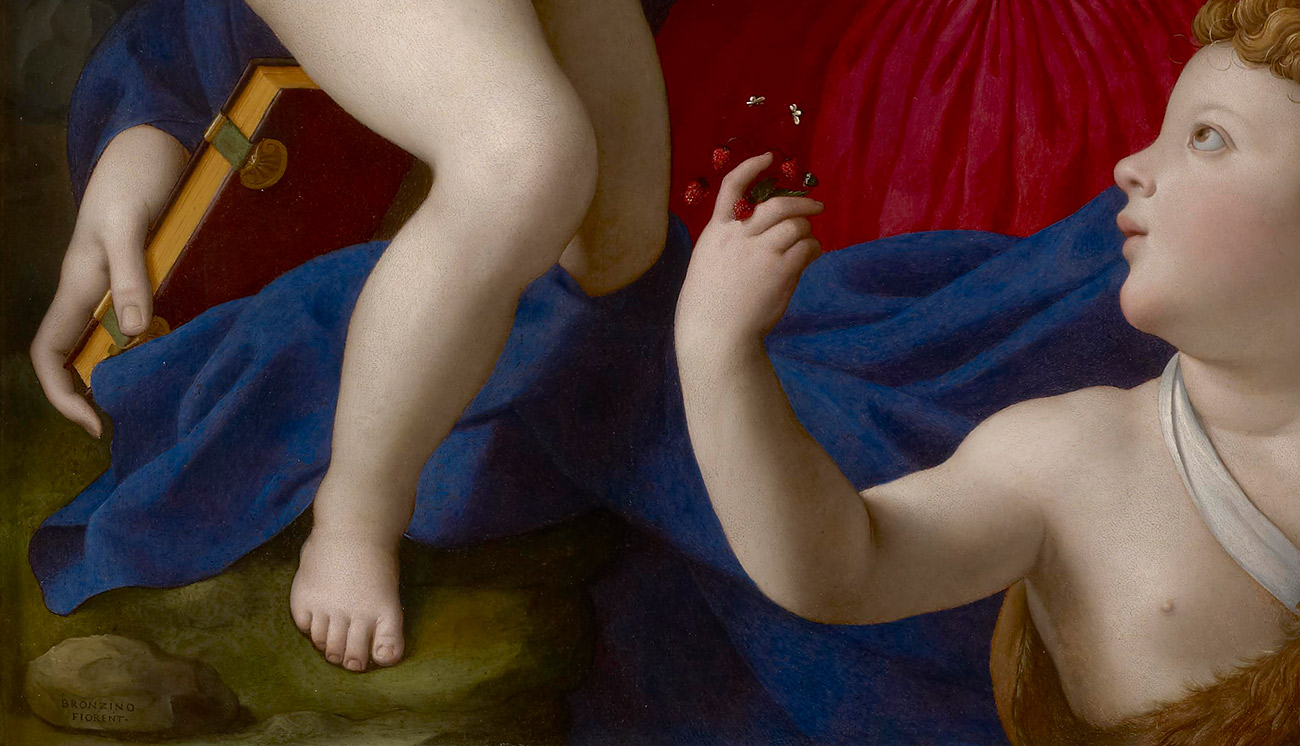 Detail of a painting showing a leg and arm and a small rock bearing the word BRONZINO