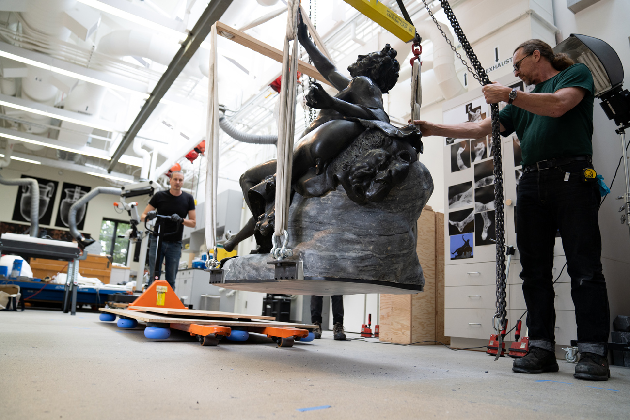 The fully reassembled sculpture is lifted to be placed on a dolly.