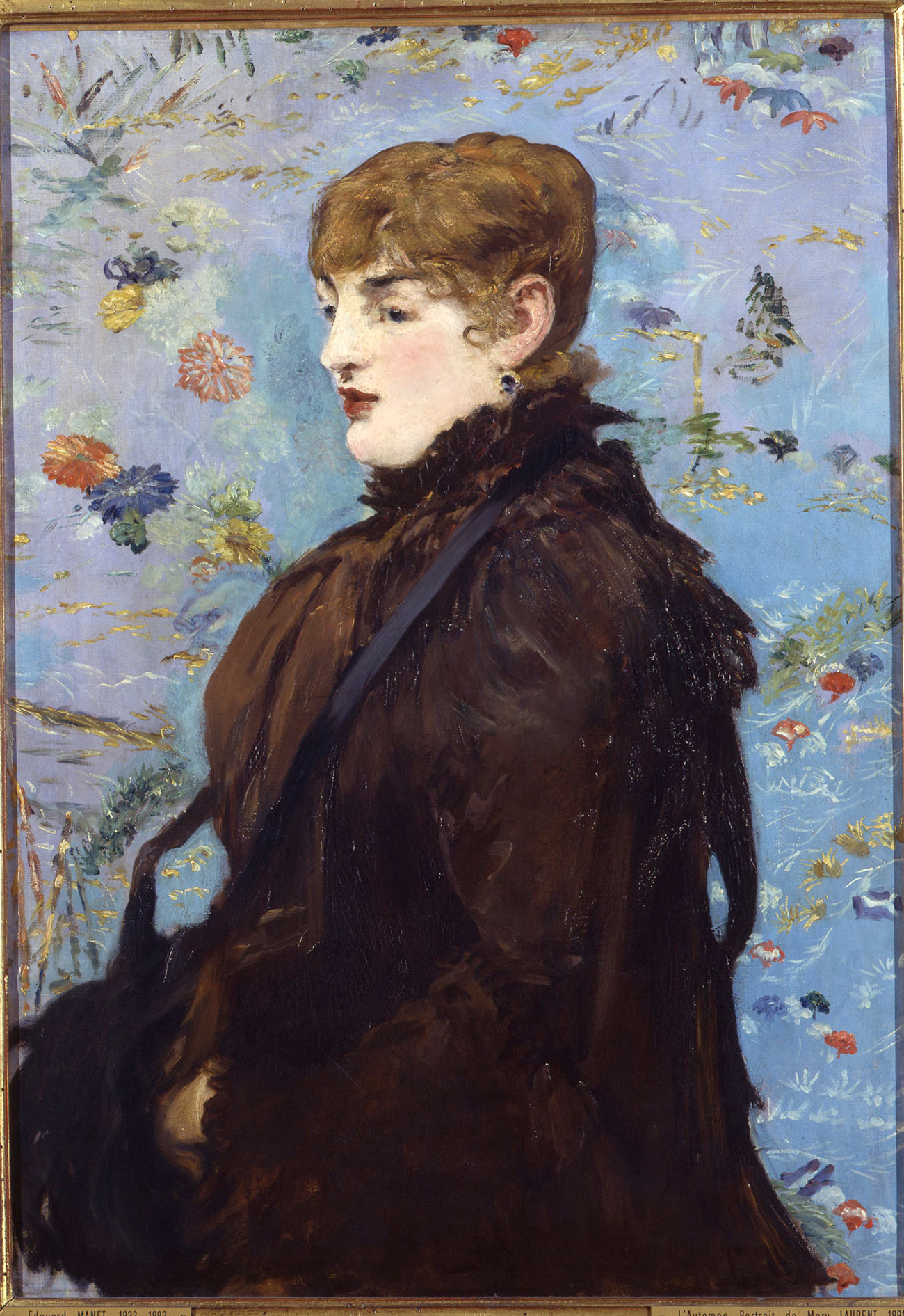 Portrait of a woman looking left, wearing a brown coat.