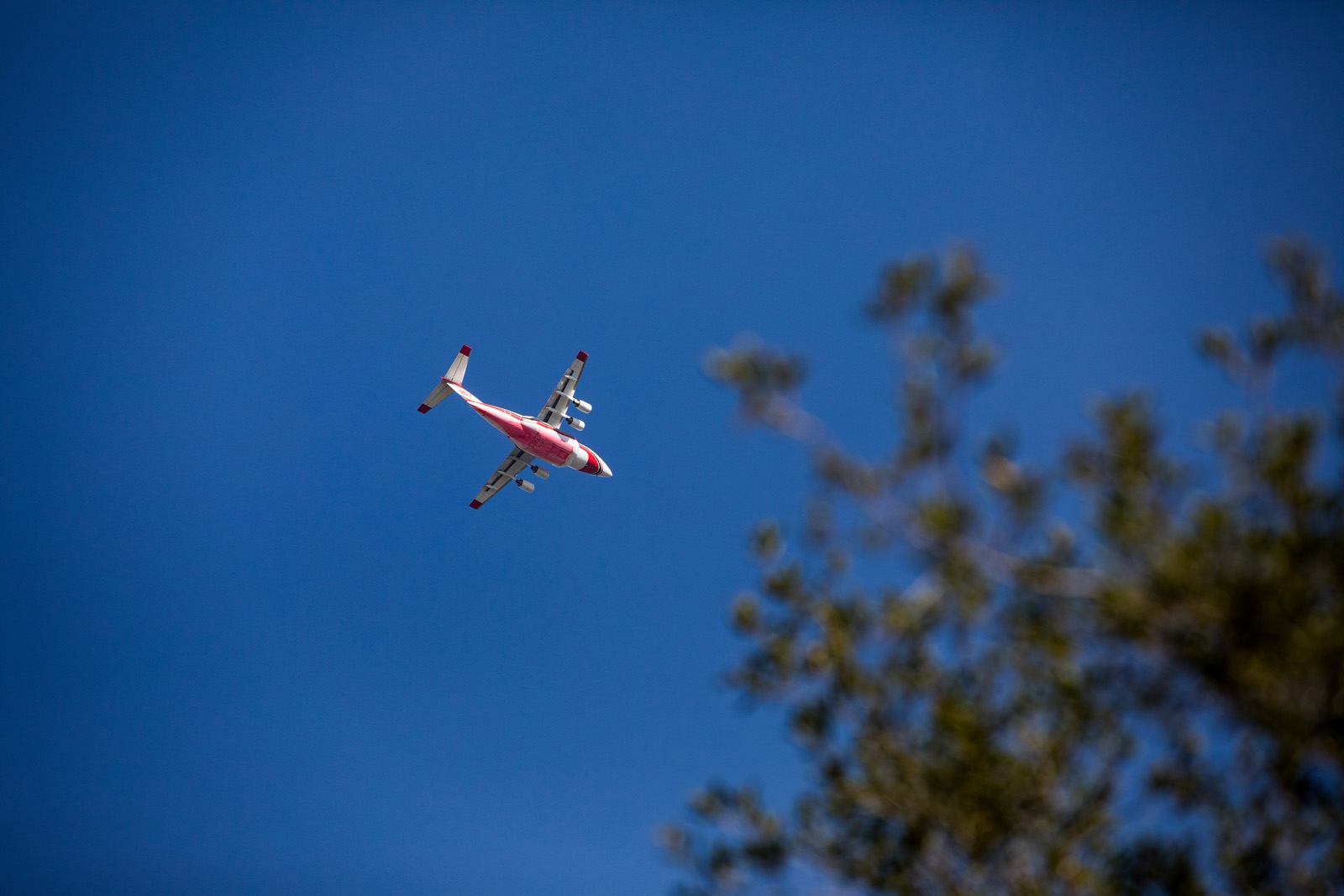 An air tanker flies over the Getty on Monday.