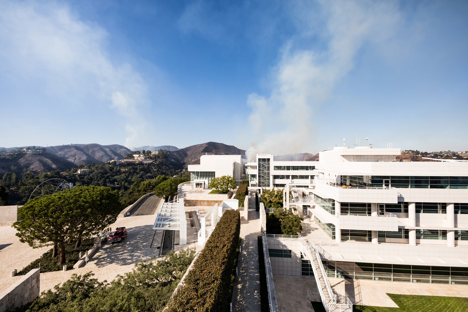 Skies cleared later on Monday afternoon, though some white smoke remained visible north of the Getty Center.