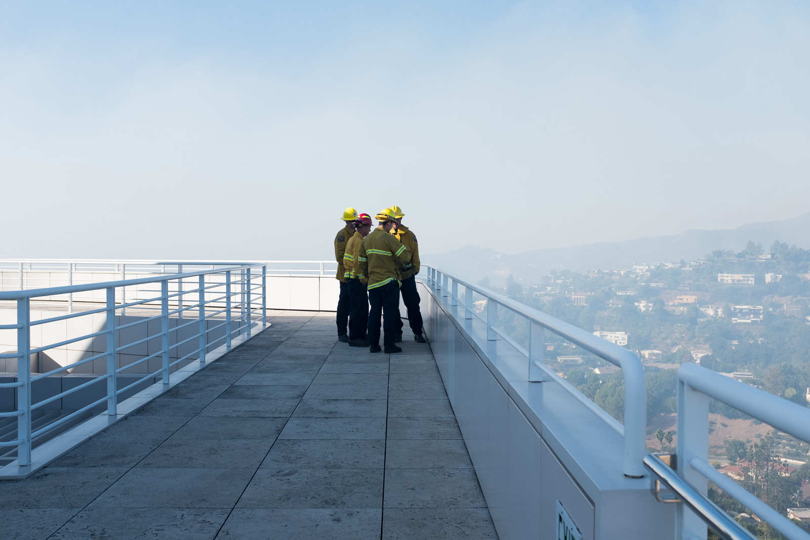 Firefighters on the Getty Center Restaurant terrace at midday Monday. The terrace has views to the west (as here) and north.