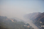 View north from the Getty Center in late morning on Monday. Smoke was heavy and moving west with the winds.