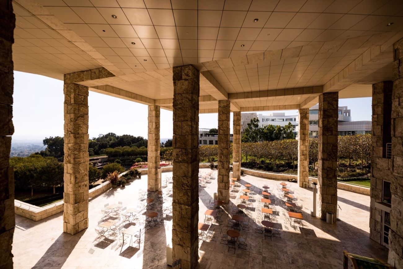 A view overlooking the Getty's Garden Terrace cafe showing large travertine columns.