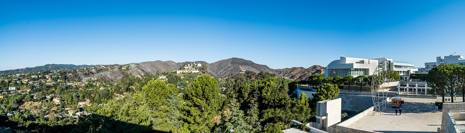 Panoramic image to the north of the Getty Center, showing distant charred hillsides as the result of the Getty Fire