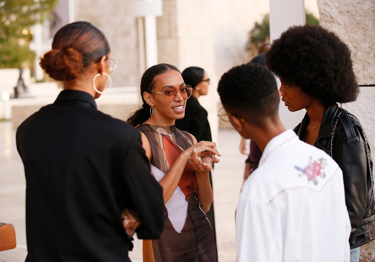 Solange Knowles in conversation with three others.