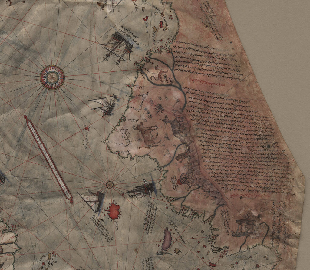 Closeup of a detailed map containing illustrations and text written over the land portion.
