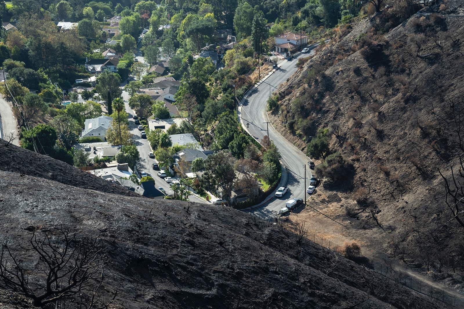 View down into neighborhood from the perspective of a burned hillside.