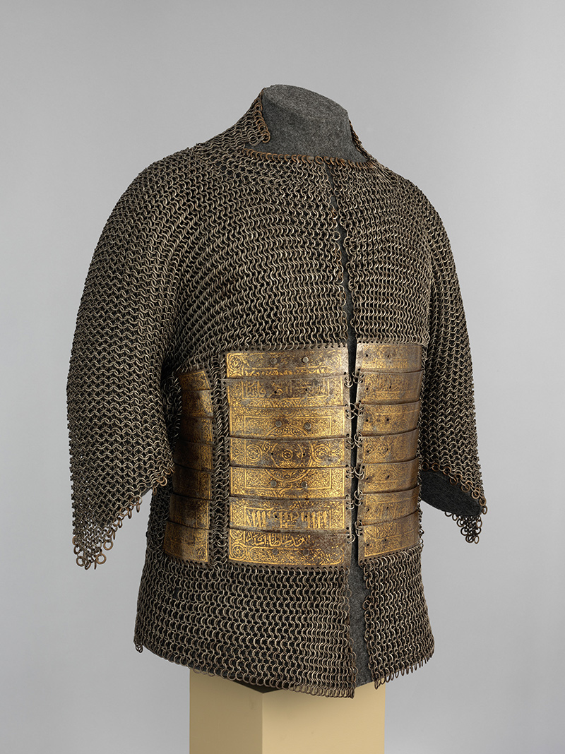 Chain mail tunic with metal plates across the abdomen.