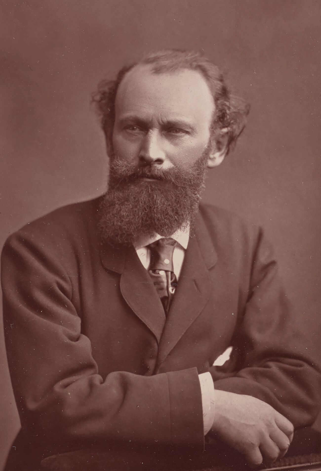 Édouard Manet, bearded and wearing a suit jacket and tie.