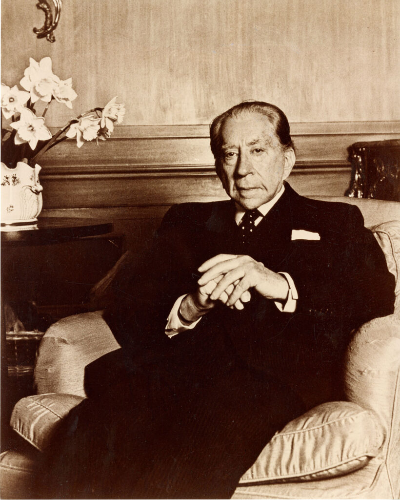 J. Paul Getty seated in an armchair.