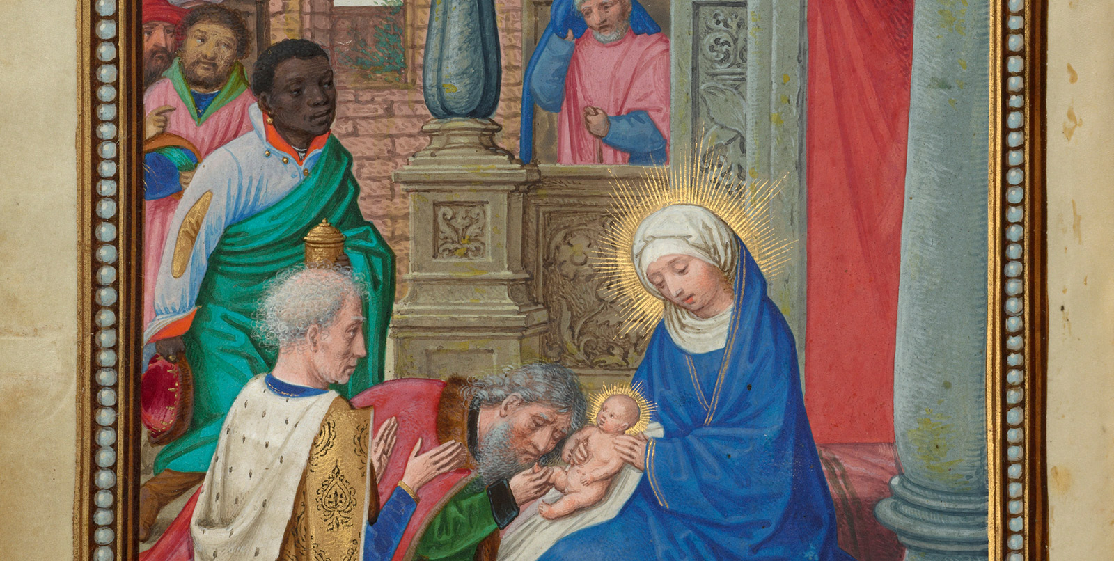 Mary holds the baby Jesus as Balthazar and others look on.