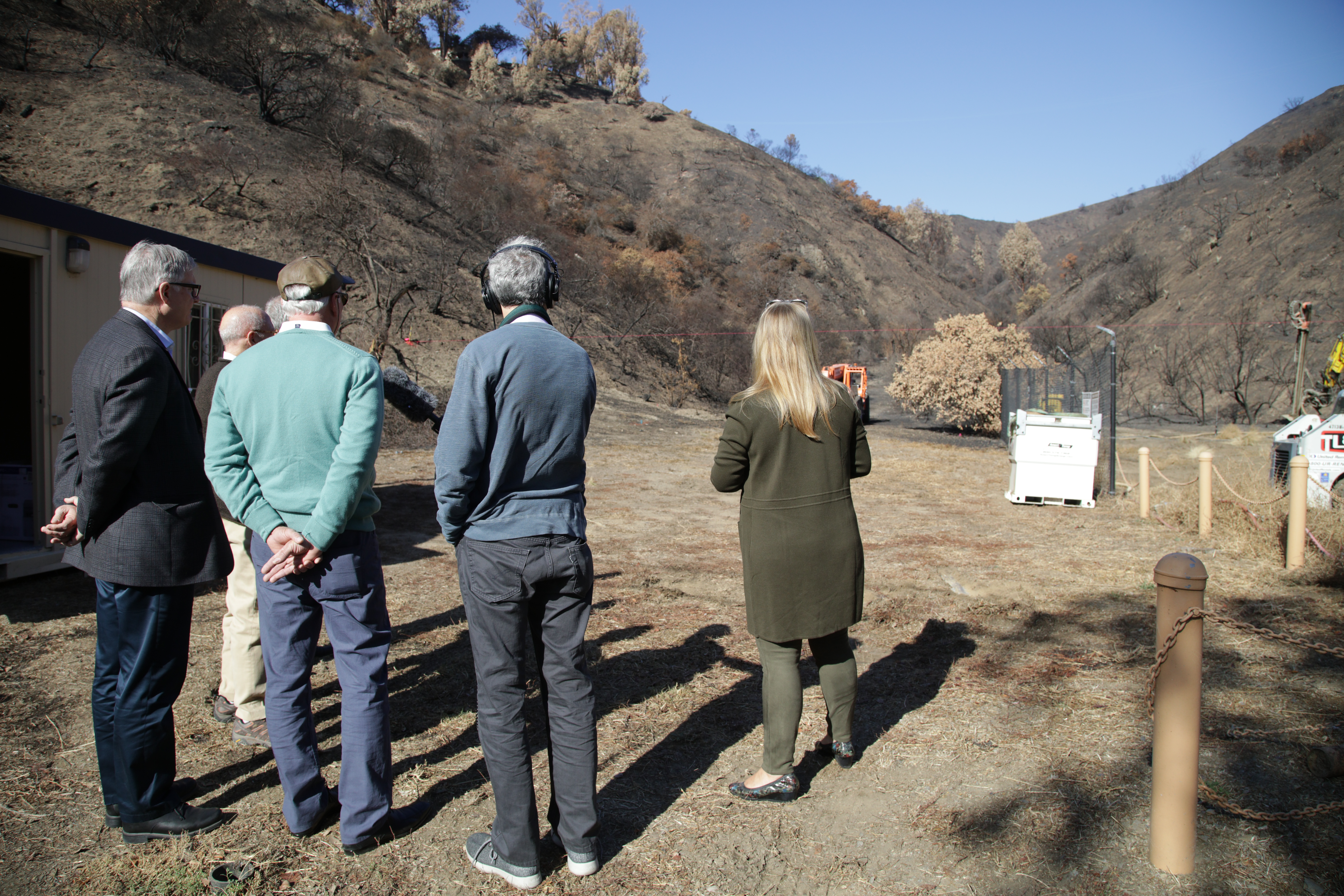 Steven Olsen, Jim Cuno, Bob Combs, Gideon Brower (audio producer), and Lisa Lapin view the construction site of new debris fences