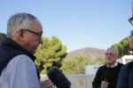 Mike Rogers (left) speaks to Jim Cuno from the Getty Center's plaza, with the fire-scarred hillside visible in the distance