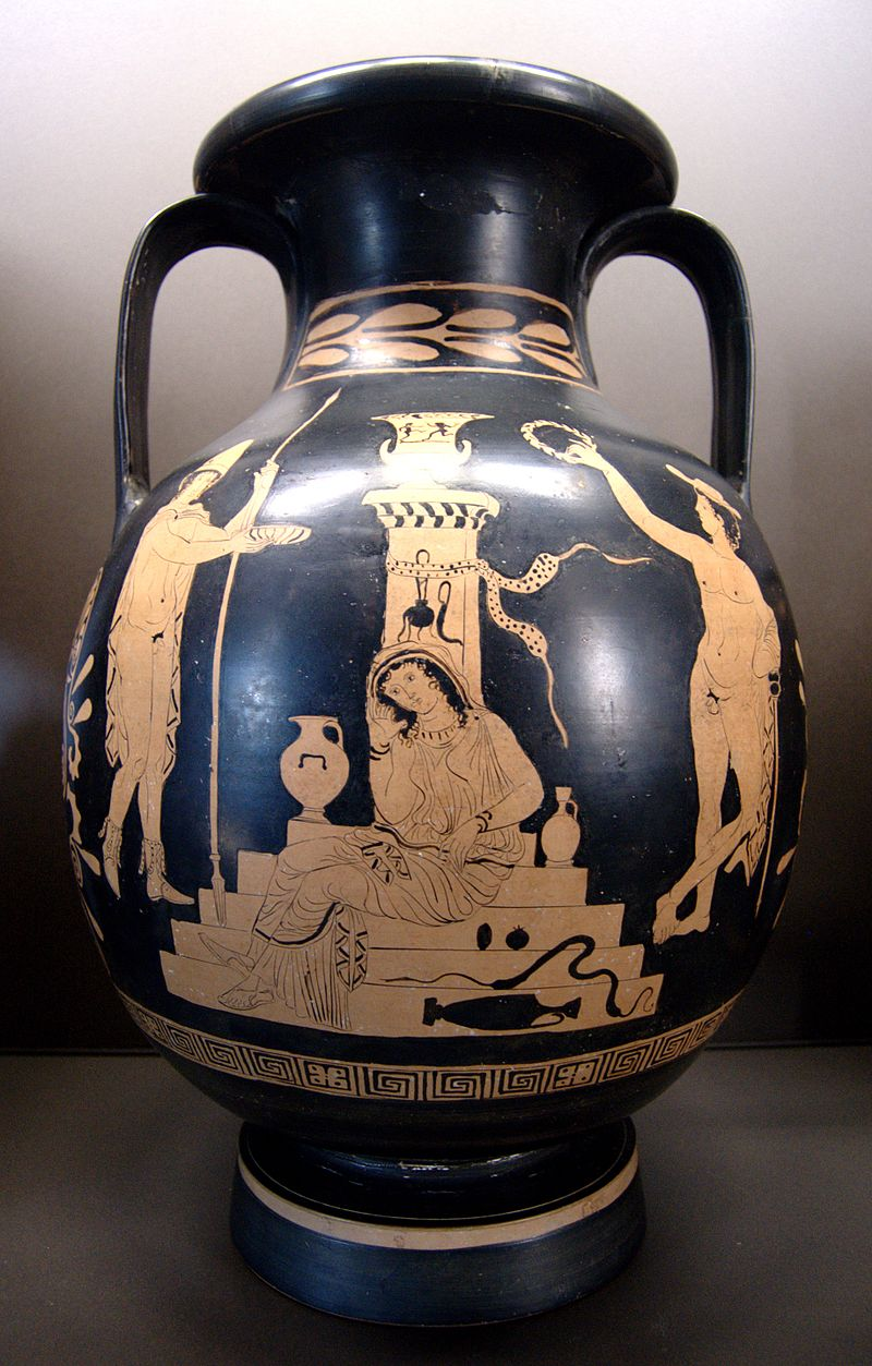 An urn depicting Elektra sitting on a set of stairs, flanked by two nude men