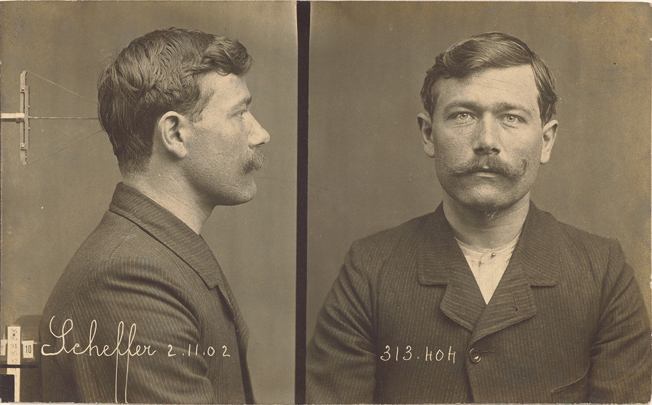 Mugshot of a man with a handlebar mustache, showing both front and profile view. Written on the print: Scheffer 2.11.02 and 313.hoh