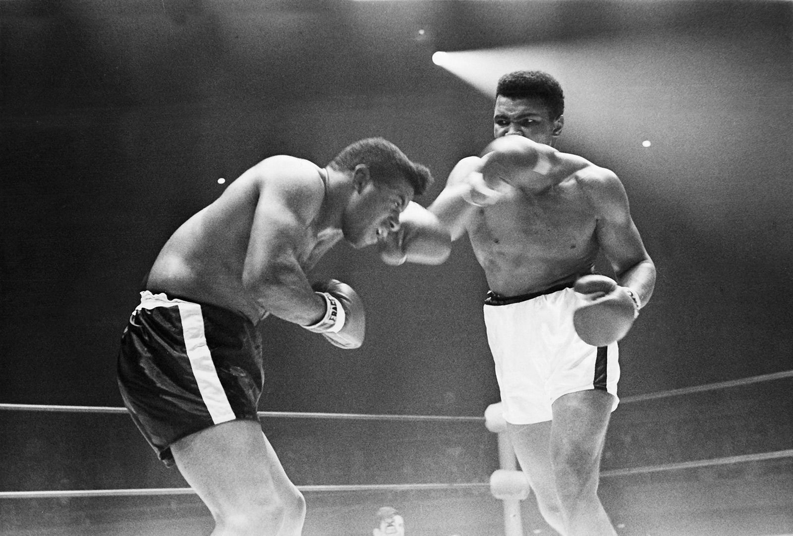 Patterson on the left deflecting with his left arm, Ali on the right on the tail end of a swing with his right.