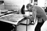 Jasper Johns working on an embossing plate for Four Panels from Untitled.  Photograph © 1974 Sidney B. Felsen