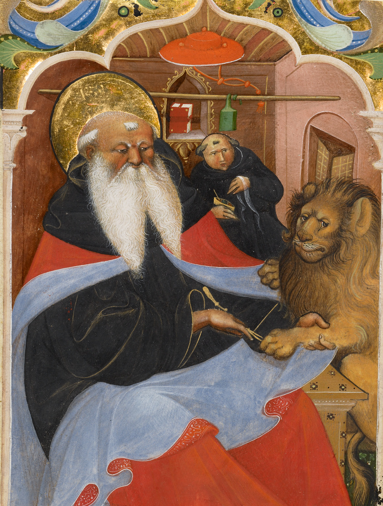 St. Jerome wears a red cape over black robes as he holds the paw of a lion on the right. A monk looks on from behind while holding a cup of soup.
