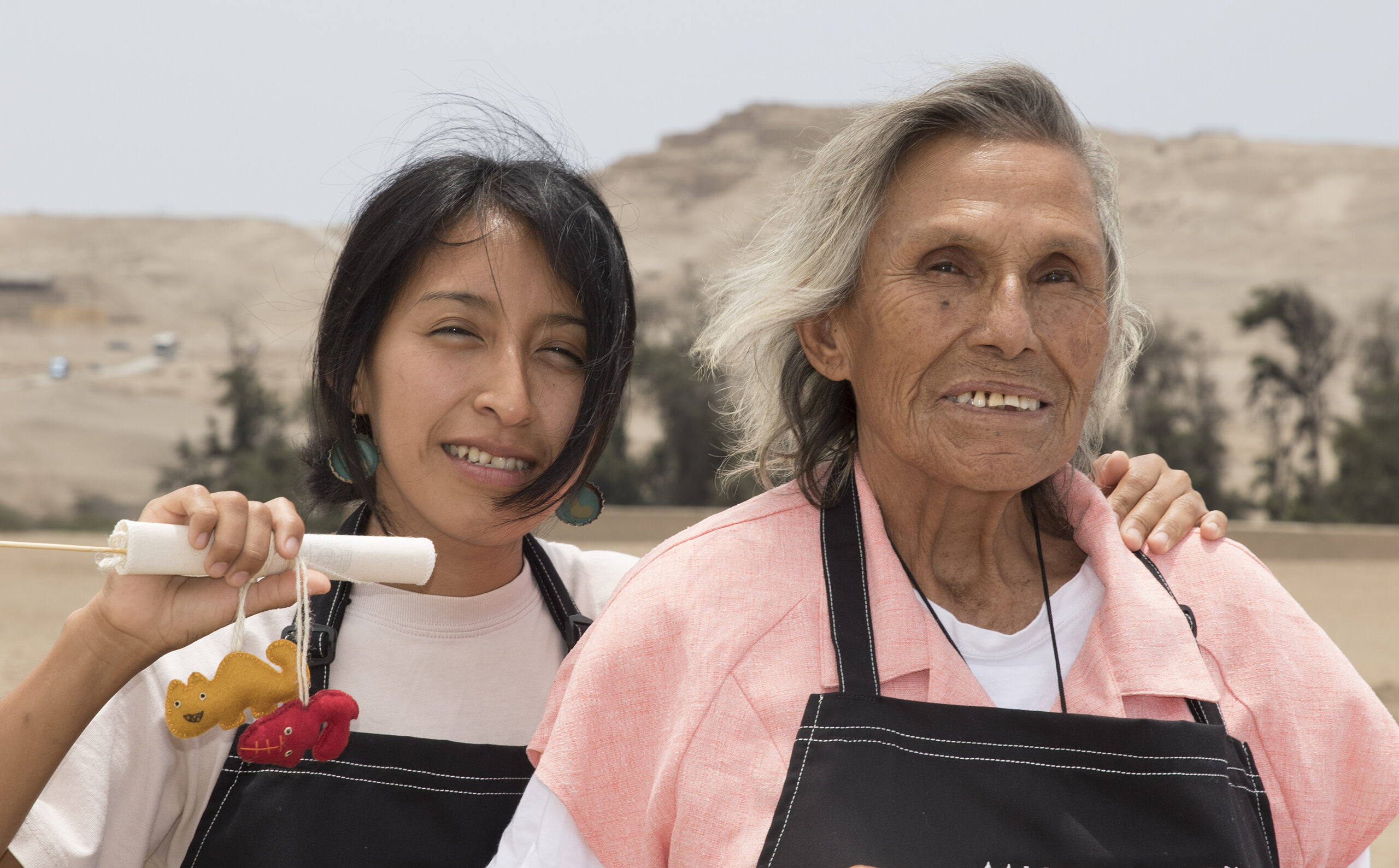 Two of the 24 members of the all-women SISAN cooperative at the site of Pachacamac, Peru