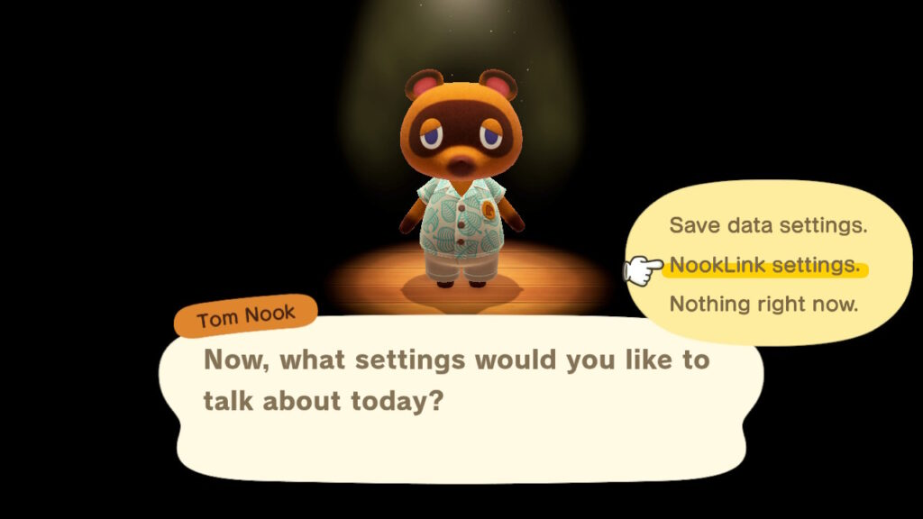 "A screenshot of the Animal Crossing settings featuring Tom Nook and a speech bubble that reads: ""Now, what settings would you like to talk about today?"""