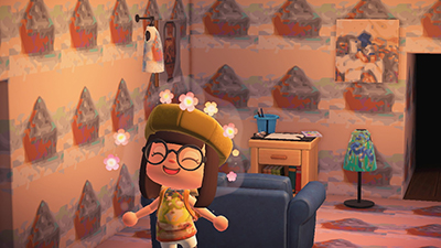 A screenshot from Animal Crossing that shows a very happy character beaming with joy wearing a shirt made from a Getty pattern. In the background, the wallpaper and floor feature a Getty artwork.