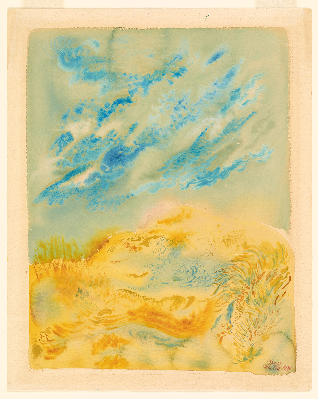 Abstract yellow sandy dunes beneath a blue and white sky