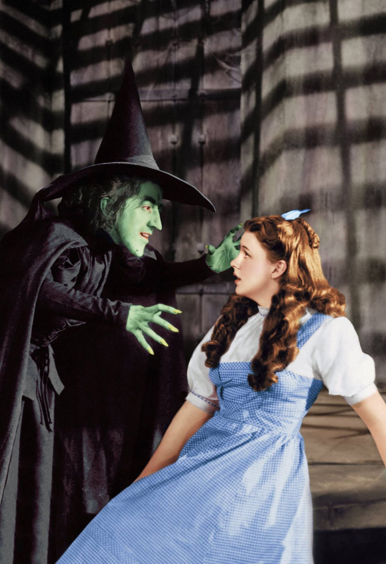 The Wicked Witch of the West looms over Dorothy