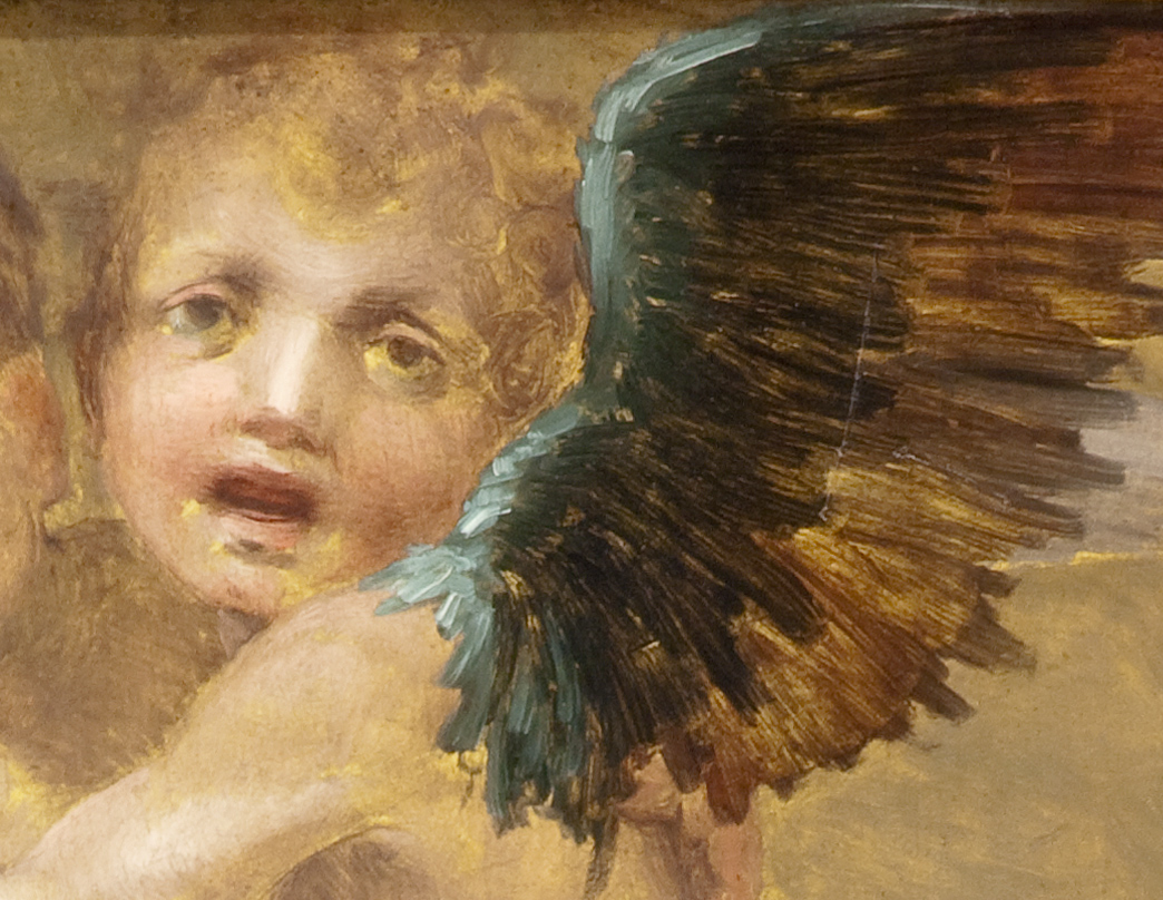 Cherub's face and wing