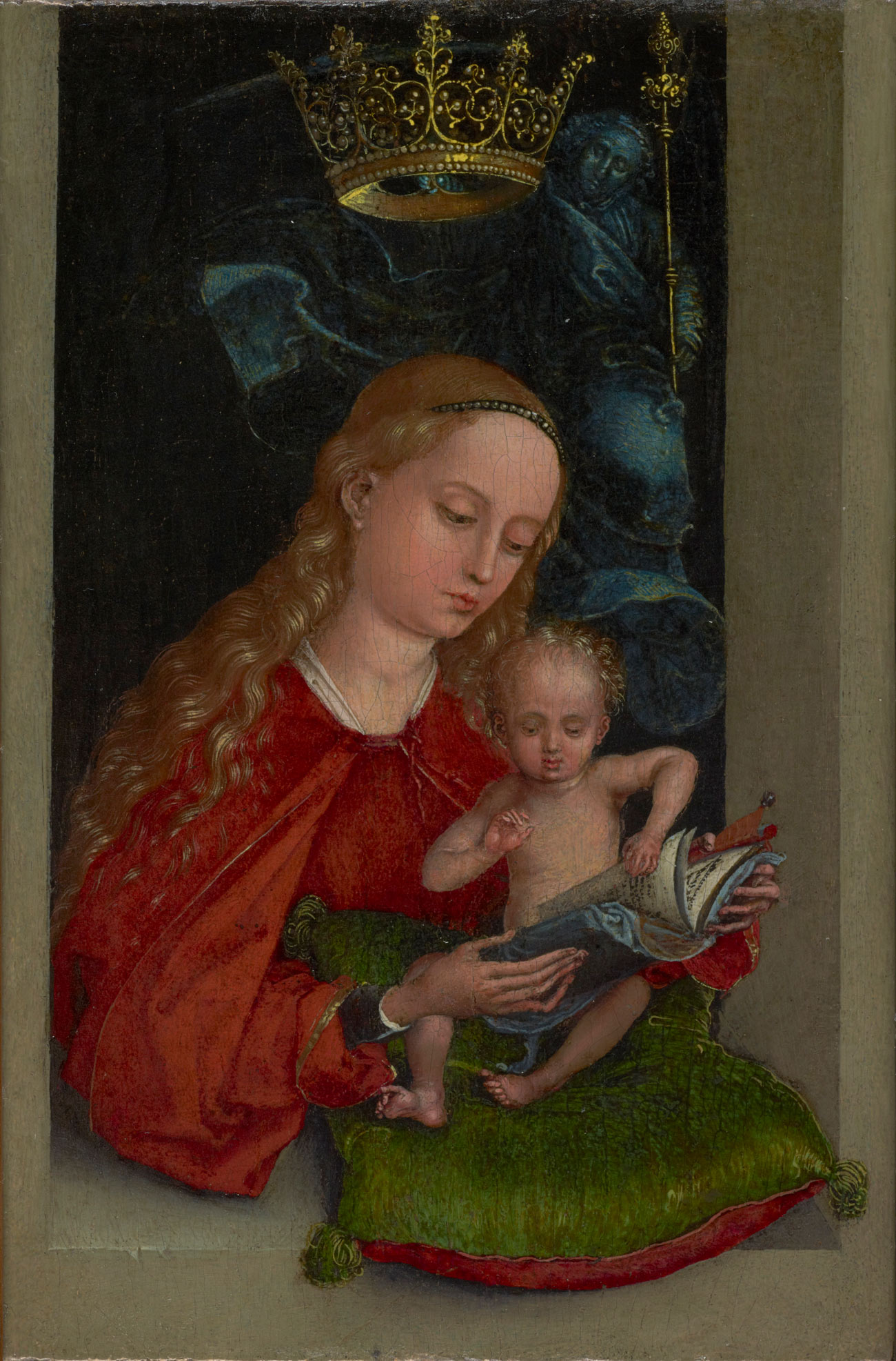 The Madonna wears read and appears to be reading to the baby Jesus, seated on a green pillow. A crown floats above.