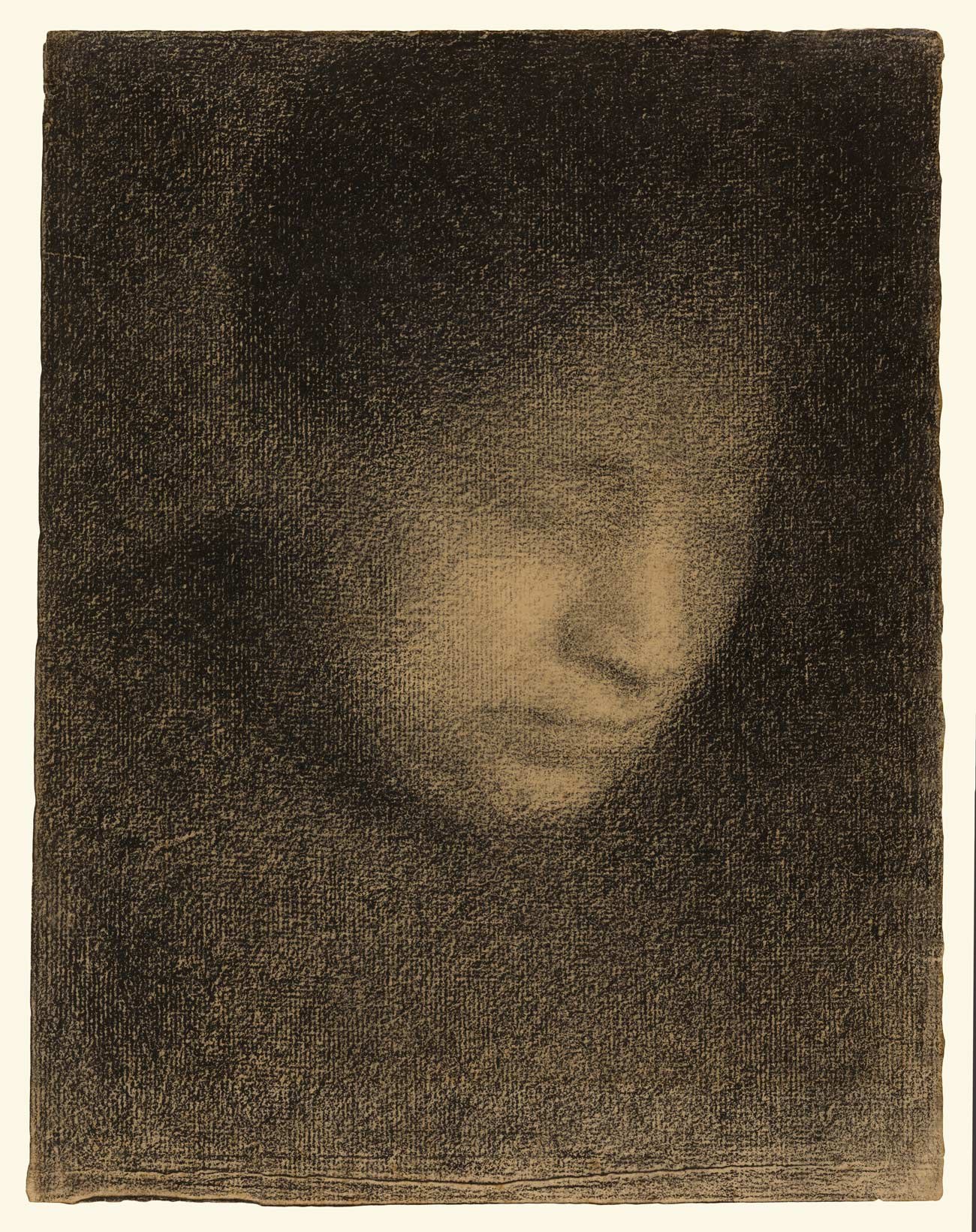 Grainy, dark image of a woman's facing looking down and to the right.