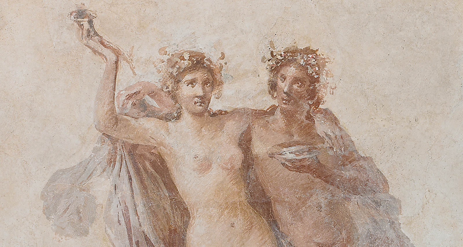 Nude classical man and woman wear laurel wreathes and hold drinks aloft