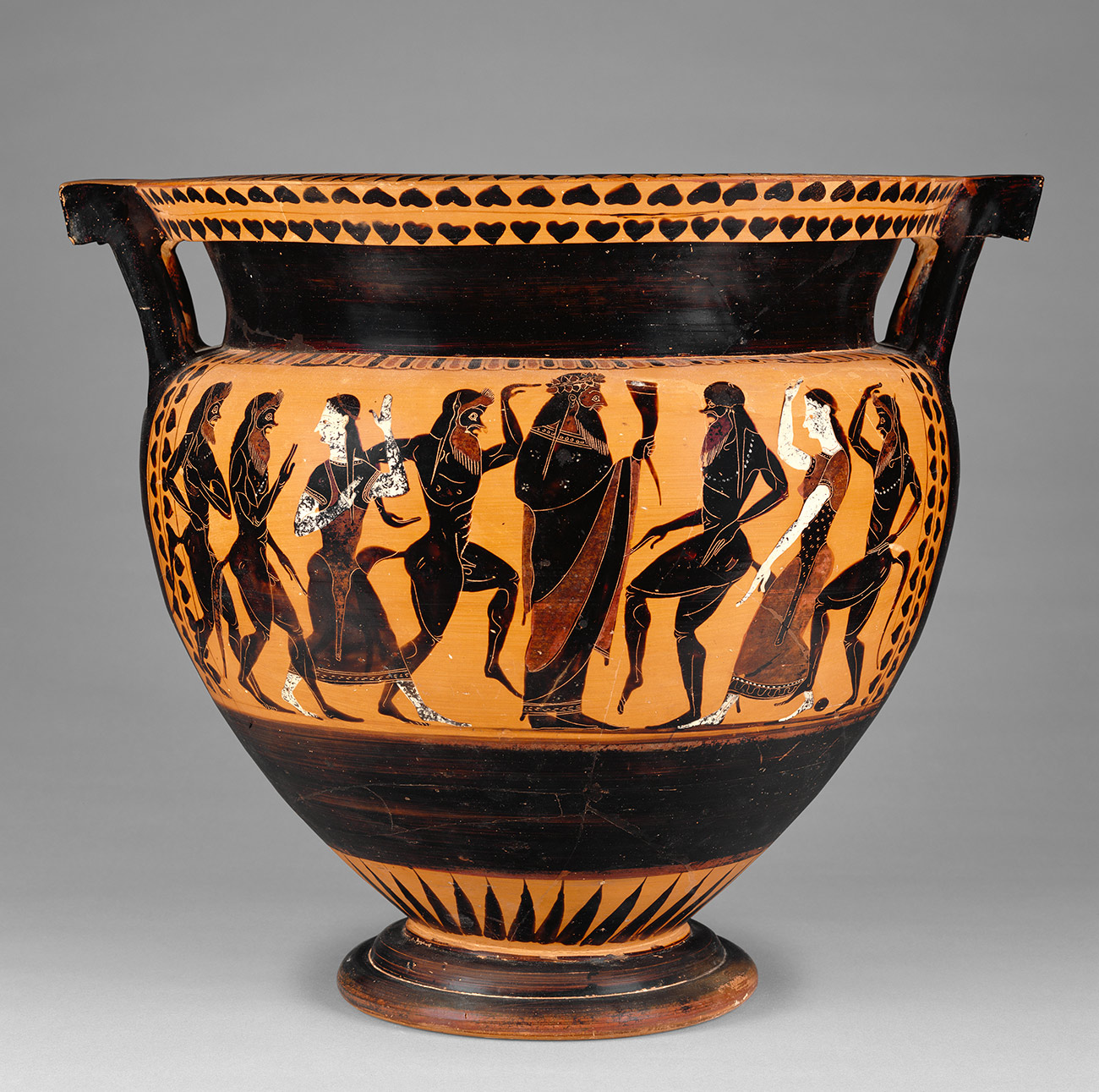 Figures dancing on a vase. Two figures are white, the other six are painted black. Amber background.