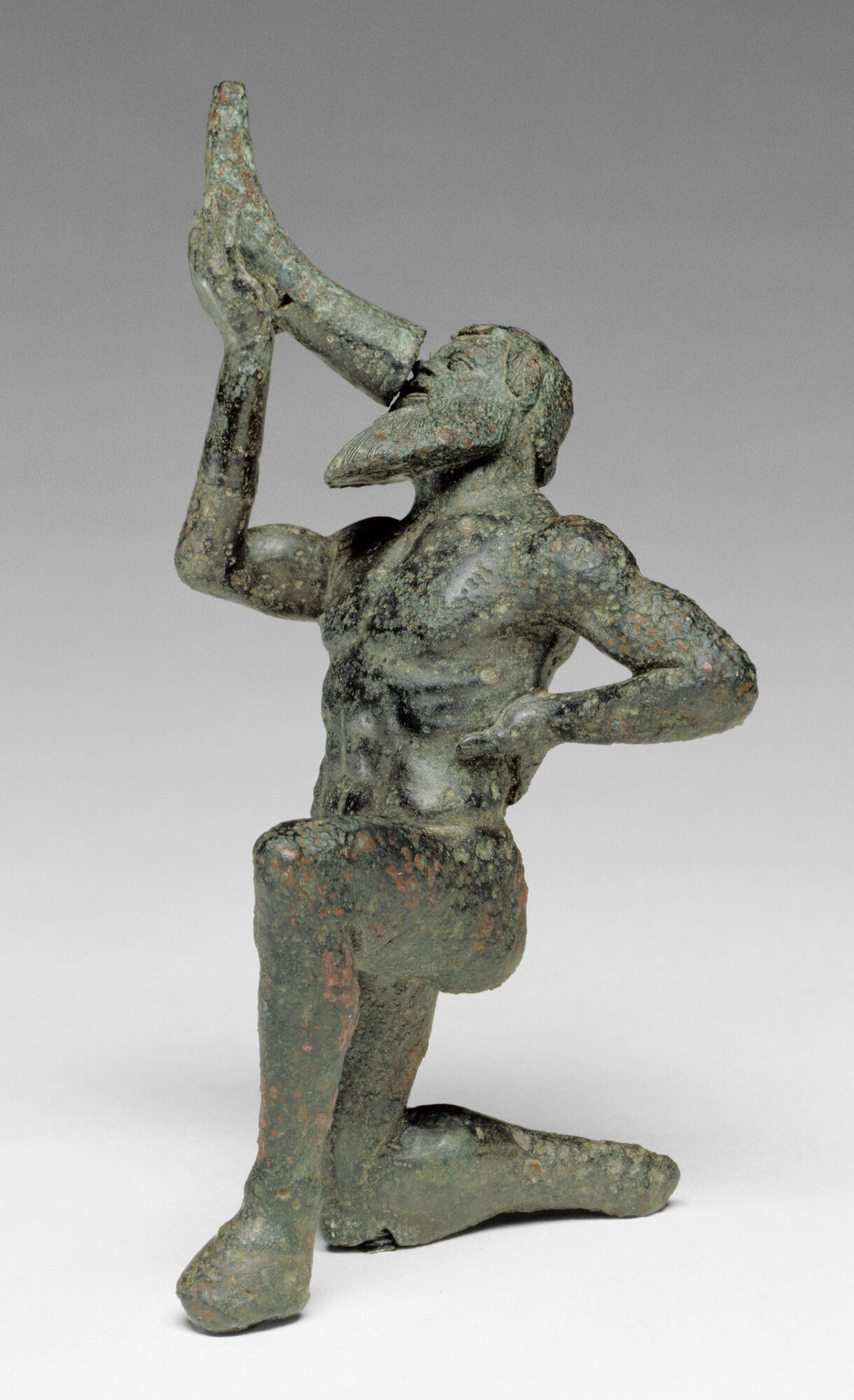 Statue of satyrl kneeling and drinking from a horn