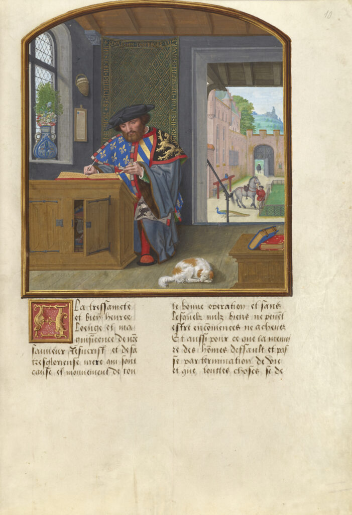 A manuscript illumination showing a medieval male scholar at a desk at left with a small brown and white dog sleeping on the floor to the right.