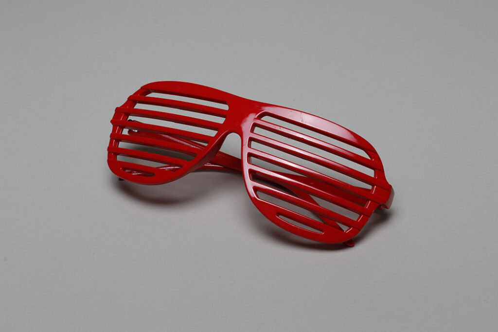 Red novelty glasses with horizontal slats instead of glass