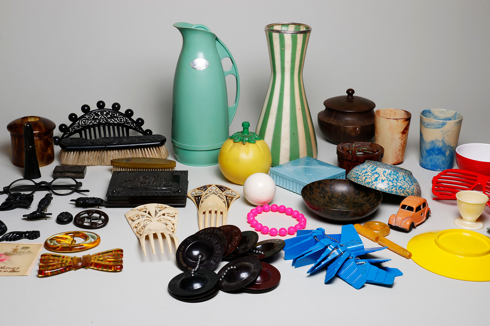 Plastic objects including combs, toys, dinnerware, pitchers, jewelry