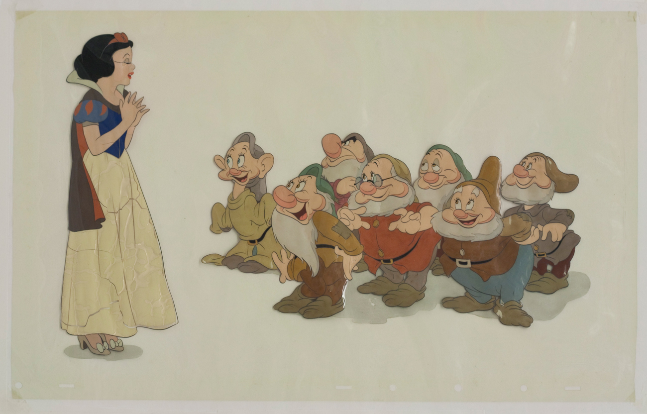 Snow White on the left facing the seven dwarves on the right