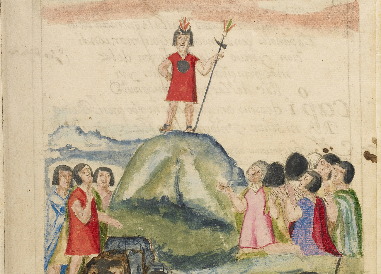 A man in red stands atop a small hill as people below look up to him