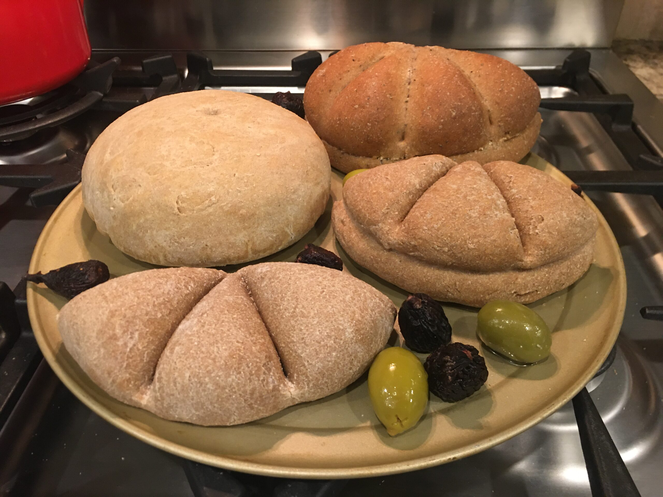 4 loaves of bread and some olives