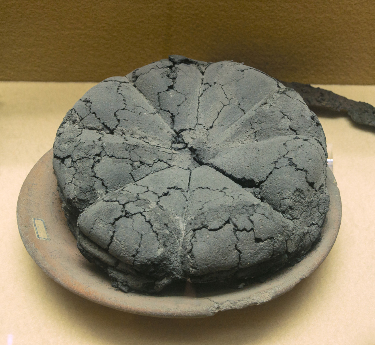 Round loaf of ancient carbonized bread.