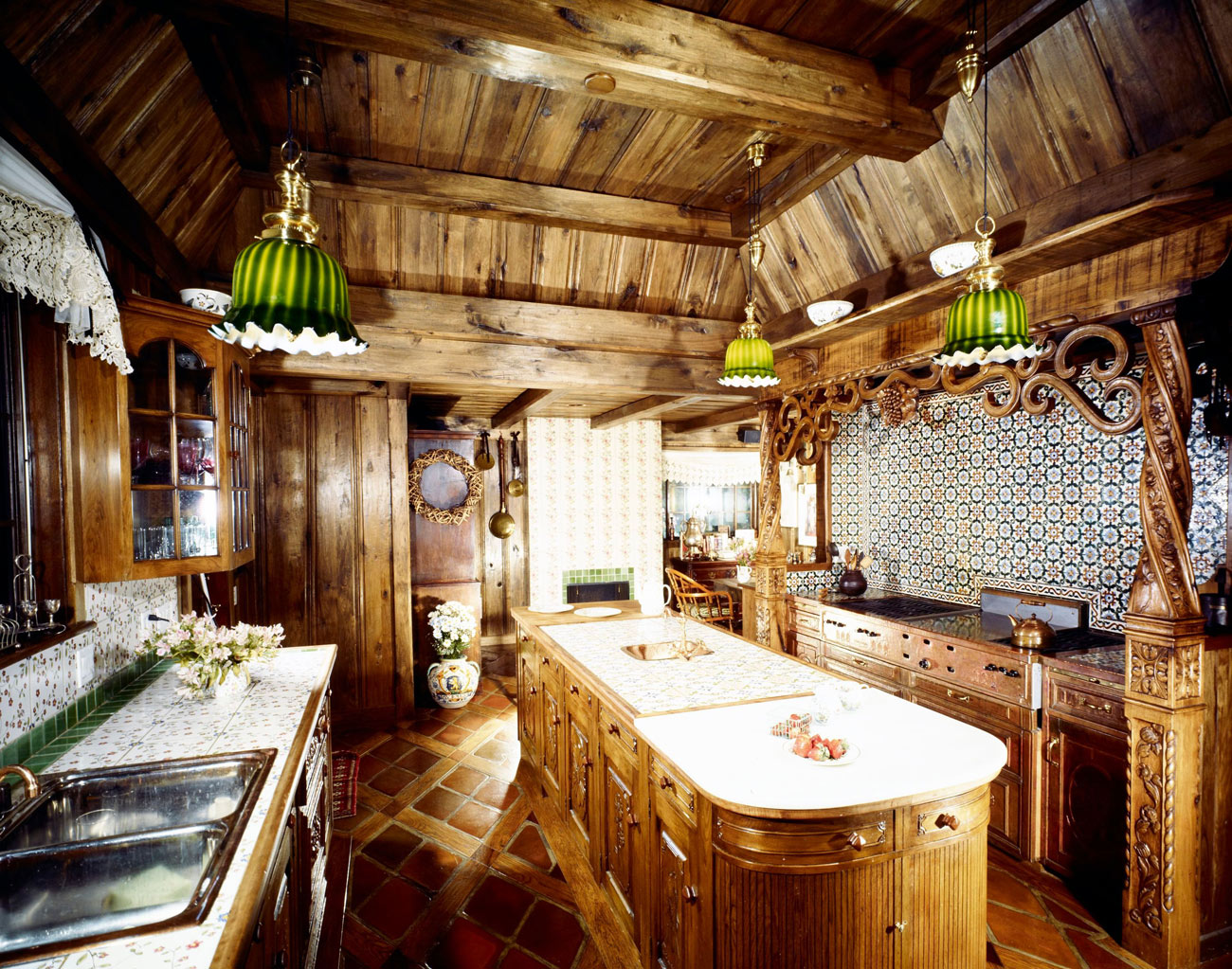 Kitchen with wood paneled walls and ceiling.