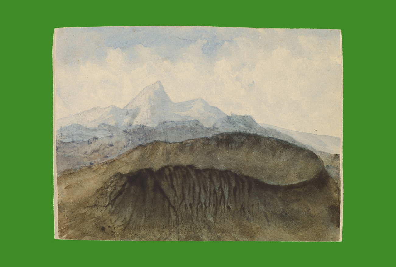 A large crater of a volcano with the peak of a distance mountain behind
