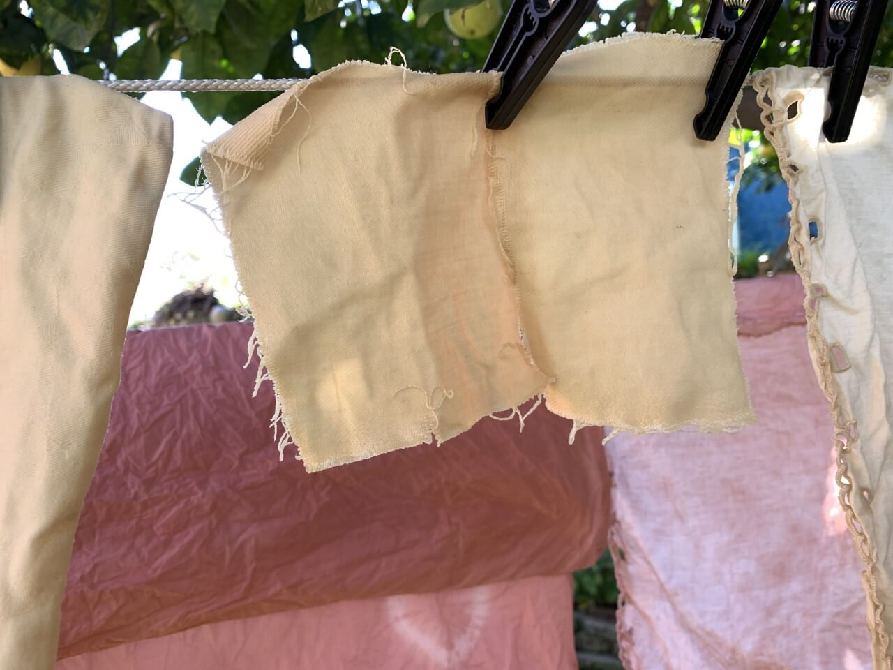 Scraps of fabric hanging from a clothesline.