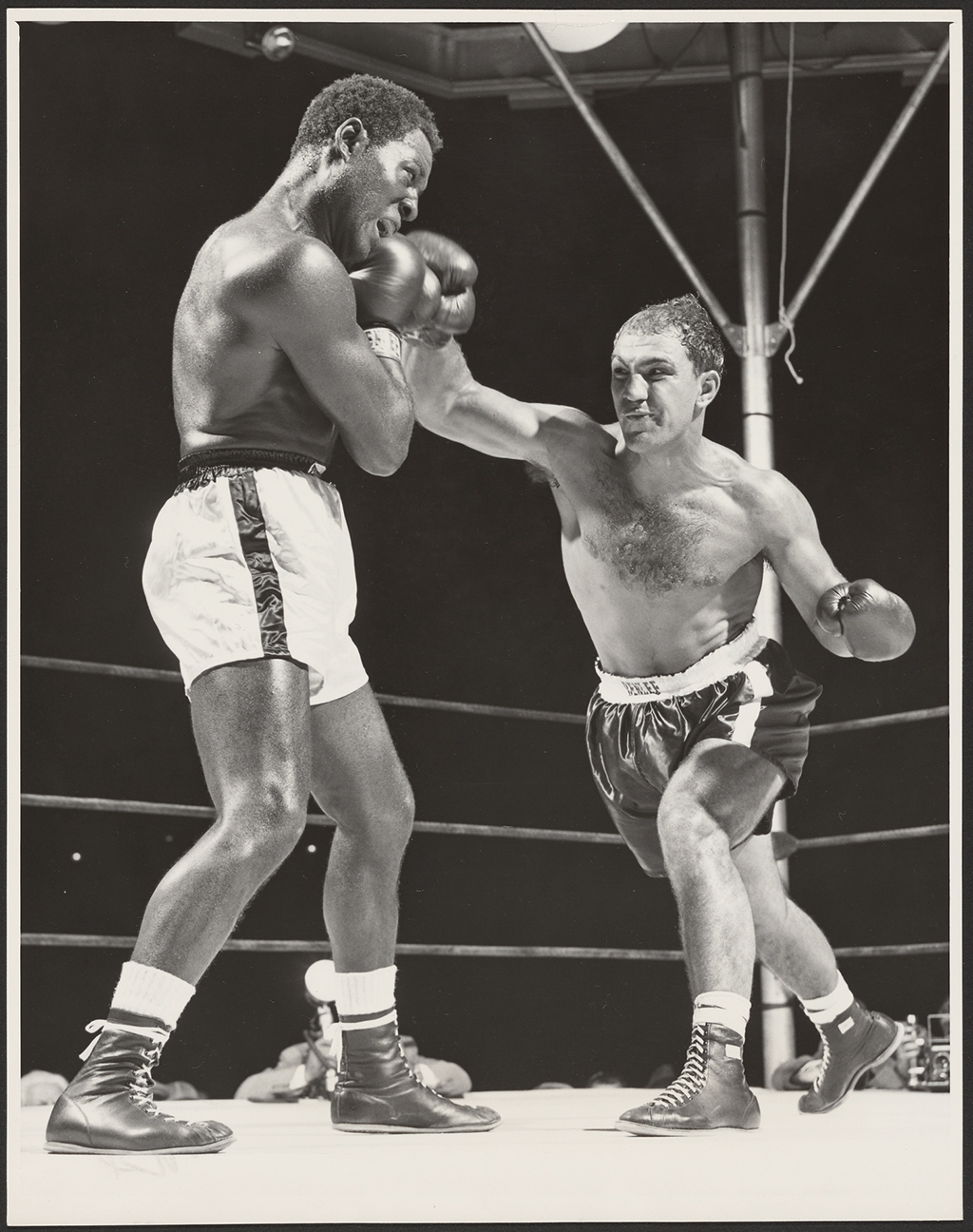 Charles, left, blocks a right cross from Marciano, right